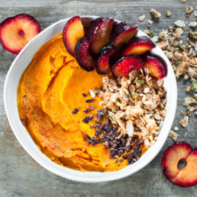 Mashed Sweet Potato with Coconut Clusters, Raw Cacao Nibs, and Sliced Plum
